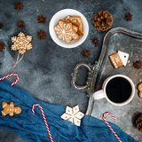 Christmas or New year breakfast. Gingerbread, candy cane and coffee cup on dark background. Flat lay. Top view copy space Royalty Free Stock Photos