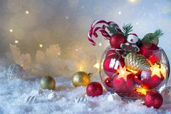 Christmas or New year bright decoration in glass vase with candy canes on snow background. Greeting card. Christmas or New year bright decoration in glass vase royalty free stock photo