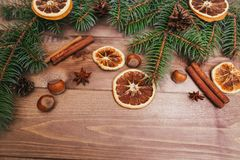 Christmas or New Year brown wooden background, Christmas food decor with fir tree.Xmas decorations, space for a text. Christmas or New Year brown wooden Stock Photos