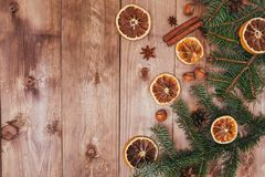 Christmas or New Year brown wooden background, Christmas food decor with fir tree.Xmas decorations, space for a text. Christmas or New Year dark wooden Royalty Free Stock Image