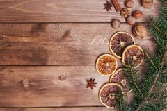 Christmas or New Year brown wooden background, Christmas food decor with fir tree.Xmas decorations, space for a text.  Stock Image
