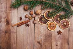 Christmas or New Year brown wooden background, Christmas food decor with fir tree.Xmas decorations, space for a text.  Royalty Free Stock Photo