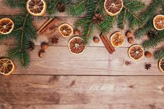 Christmas or New Year brown wooden background, Christmas food decor with fir tree.Xmas decorations, space for a text. Christmas or New Year brown wooden Stock Photography