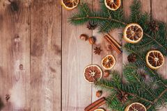 Christmas or New Year brown wooden background, Christmas food decor with fir tree.Xmas decorations, space for a text. Christmas or New Year brown wooden Stock Image