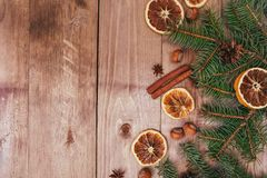Christmas or New Year brown wooden background, Christmas food decor with fir tree.Xmas decorations, space for a text. Christmas or New Year brown wooden Stock Photo