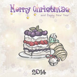Christmas and the new year with a cake and a bell. Royalty Free Stock Image