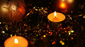 Christmas New Year candle Gold sparkling Background. Close-Up. Christmas and New Year celebration. 1080p Full HD video footage
