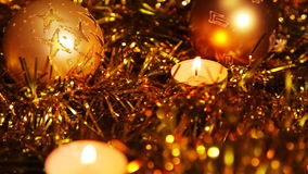Christmas New Year candle Gold sparkling Background. Close-Up. Christmas and New Year celebration. 1080p Full HD video footage stock footage