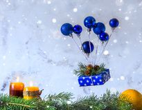 Christmas and new year card. Air balloon of Christmas toys and g. Ift box levitation. Copy space for text royalty free stock image