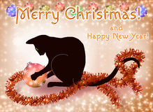 Christmas and New Year card with a black cat. Merry Christmas and Happy New Year card with a black cat playing with a ball Stock Photography