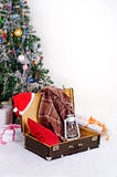 Christmas new year card suitcase Santa Claus with gifts. The composition is shifted to the inscription stock image
