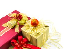 Red and gold gifts box and decorating elements on white background. Stock Photography