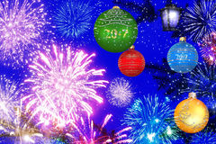 Christmas New Year celebration fairy night. Colorful baubles of the christmas tree branches and holiday fireworks against the dark blue sky. Christmas New Year Stock Photo