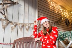 Christmas or New Year celebration. Happy woman in the Santa Claus hat. looking at the camera. Stock Photo