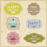 Christmas and New Year 2015 celebration vintage label or sticker. Merry Christmas and Happy New Year 2015 celebration label, sticker or tag on grungy beige Stock Photo