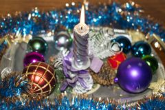 Christmas and New Year. Christmas candle and toys. royalty free stock photo