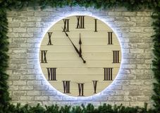 Round Christmas or New Year clock on brick wall. Happy new year concept. 2019 stock images