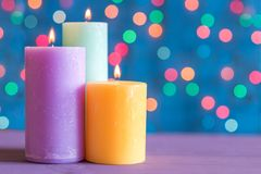 Christmas and new year colored burning candles on the background bokeh Stock Photo
