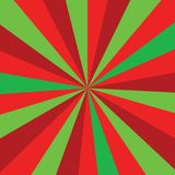Christmas or new year colored sunburst ray  pattern with red and green diagonal line, stripes background. Sunburst ray  Christmas or new year colored pattern Stock Photos