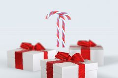 Christmas New Year colorful gift boxes with bows of ribbons and stripped candy cane on the white background. 3d illustration with. Space for your text Stock Photo