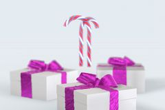 Christmas New Year colorful gift boxes with bows of ribbons and stripped candy cane on the white background. 3d illustration with. Space for your text Royalty Free Stock Images
