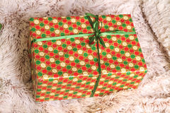 Christmas and New Year colorful gift under the tree on the rug Stock Photography
