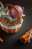 Basket with Christmas decorations on black background Royalty Free Stock Image