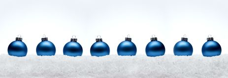 Christmas New Year composition balls  with snow line white backg. Round blue fir tree toy concept web design banner panorama ultra wide Royalty Free Stock Photo
