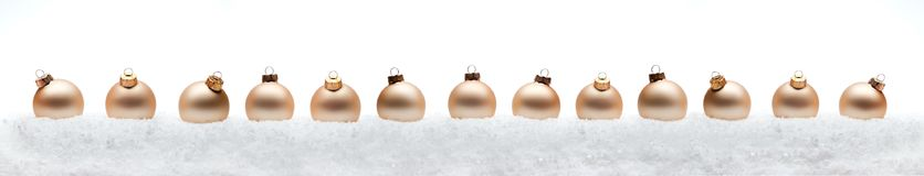 Christmas new year composition balls  with snow line white backg Royalty Free Stock Image