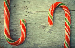 Christmas, New Year Composition with Candy Canes. Shiny Holiday Decoration on Blue Wooden Background Stock Images