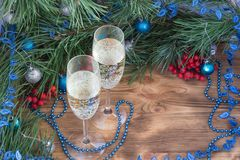 Christmas and New Year composition, champaign, pine, ornament de. Christmas and New Year still life composition with two champaign glasses, pine tree acerose royalty free stock images