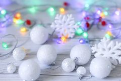New year or Christmas decorations in silver and white colors with balls, snowflakes and garland bokeh. Christmas or new year composition. Christmas decorations royalty free stock photo