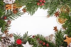 Christmas New Year composition with cinnamon sticks, st. Top view Christmas New Year composition with cinnamon sticks, star anise on wooden background, frame Stock Photos
