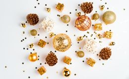 Christmas or new year composition. christmas decorations in gold colors on white background with empty copy space for text. holida. Y and celebration concept for royalty free stock images