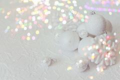 Christmas or new year composition. Christmas decorations in silver and white colors with balls and snowflake. Retro design with bokeh royalty free stock photo
