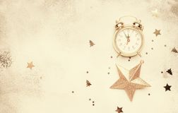 Christmas or New Year composition, frame, gray background with g. Old Christmas decorations, star and alarm clock, vintage toned image, top view royalty free stock images