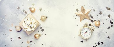 Christmas or New Year composition, frame, gray background with g. Old Christmas decorations, stars, snowflakes, balls, alarm clock, gift box, banner, top view royalty free stock photos