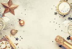 Christmas or New Year composition, frame, pink background with g. Christmas or New Year composition, frame, gray background with gold Christmas decorations royalty free stock photo
