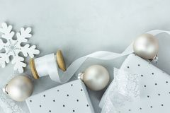 Christmas New Year Composition Gift Boxes White Silk Curled Ribbon Snow Flake Ornament Balls on Gray Stone Background Royalty Free Stock Photo