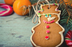 Christmas, New Year Composition with Gingerbread Man, Tangerines and Candy Canes. Shiny Holiday Decoration Royalty Free Stock Photos