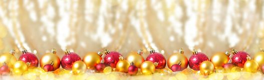 Christmas new year composition with gold red balls row Line background holiday decoration toy concept long banner. Web design Royalty Free Stock Images