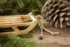 Free Christmas New Year Composition. Pine Cone And Sled On Old Rustic Wooden Background. Holiday December Decoration, Time For Royalty Free Stock Image - 164080516