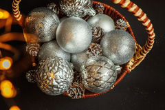 Basket with Christmas decorations on black background Royalty Free Stock Photography