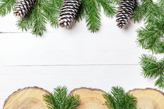 Christmas New Year composition with tangerines, cones, nuts, wicker basket and fir branches in rustic style on old. Wooden background, selective focus Stock Photos
