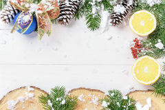 Christmas New Year composition with tangerines, cones, nuts, wicker basket and fir branches in rustic style on old Royalty Free Stock Photography
