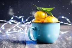 Christmas New Year Composition with Tangerines Wooden Background Holiday Decoration to Russian Tradition Cup of citrus Toning Snow Stock Image