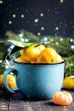 Christmas New Year Composition with Tangerines Wooden Background Holiday Decoration to Russian Tradition Cup of citrus Vertical Sn Royalty Free Stock Photography