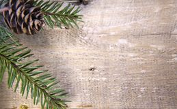 Christmas and New Year Concept. Fir tree branch with cone out of focus on wooden board, Top view, flat lay Stock Image
