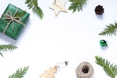 Christmas, New Year concept frame with a gift and festive decoration on the white background. Copy space winter holiday composition stock photography