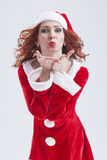 Christmas and New Year Concept and Ideas. Sexy Looking Young Caucasian Red Haired Female in Santa Hat Royalty Free Stock Images